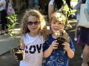 Taking home plants to grow in their family garden! Happy children.