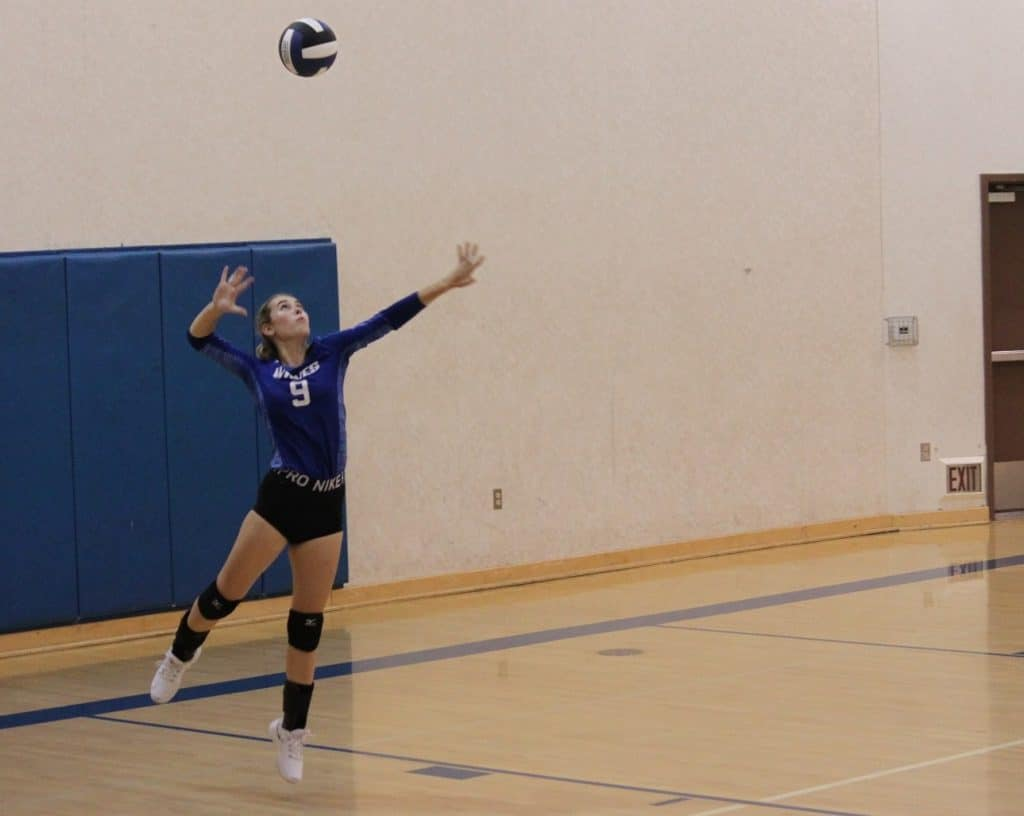 Ripley Hanson, class of 2020, serving a volleyball