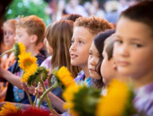 2019 Opening Day Ceremony 2nd Grade Students with Sunflowers QBacon.com